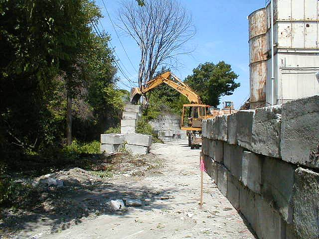 Moving the encroaching wall, July 2002. [Click to enlarge.]