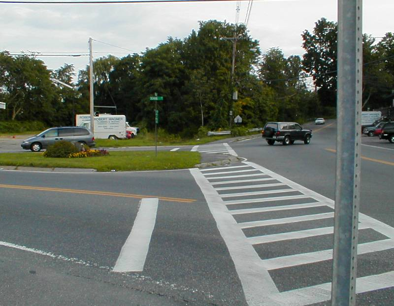 010818NorthEndOfCRT Let's head back from the northeast end of the CRT, at School and Central in Saxonville. The CRT starts at that street sign. The near end of the crosswalk aims right at it; we hope Framingham will line up the far side, as well.