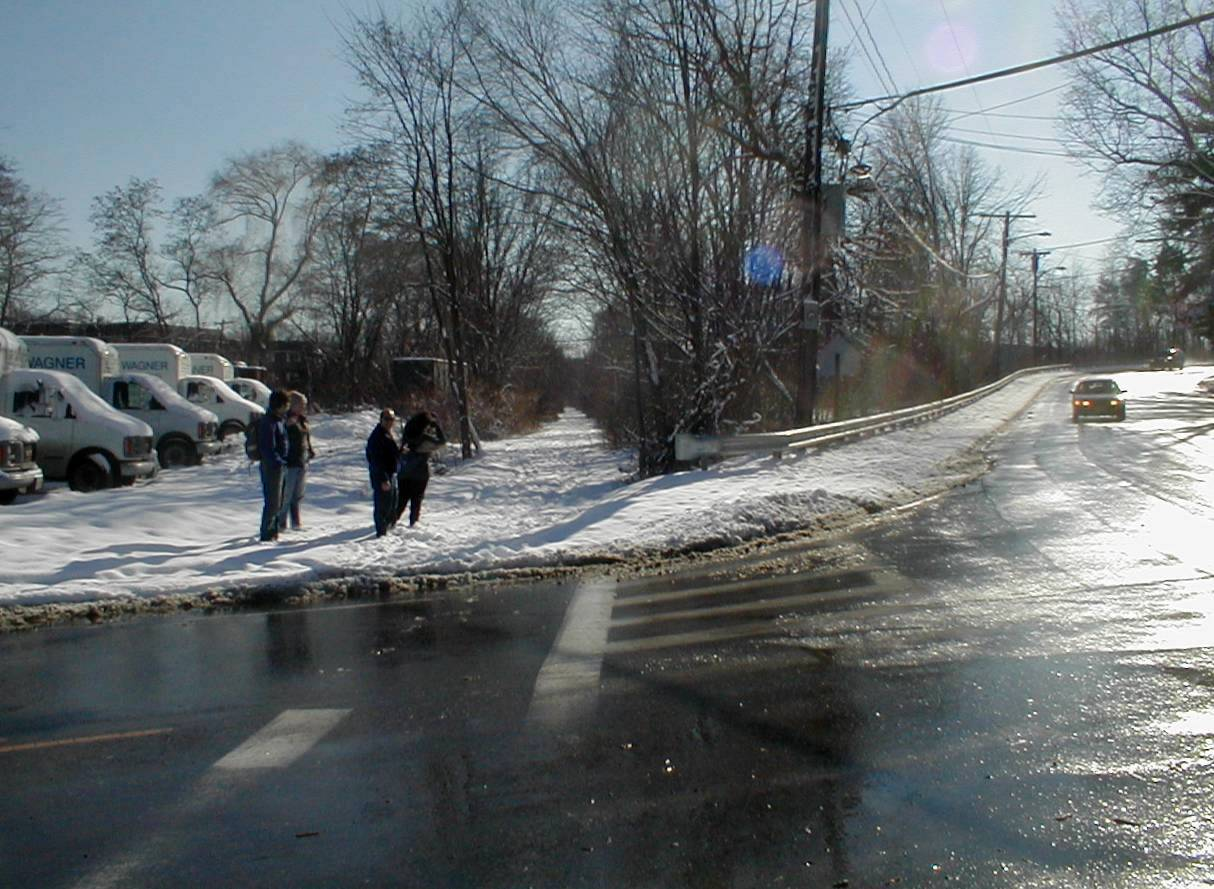 020120CRTSchoolSt In snow, that trail and the mis-aligned crosswalk are more obvious than in the prior photo.